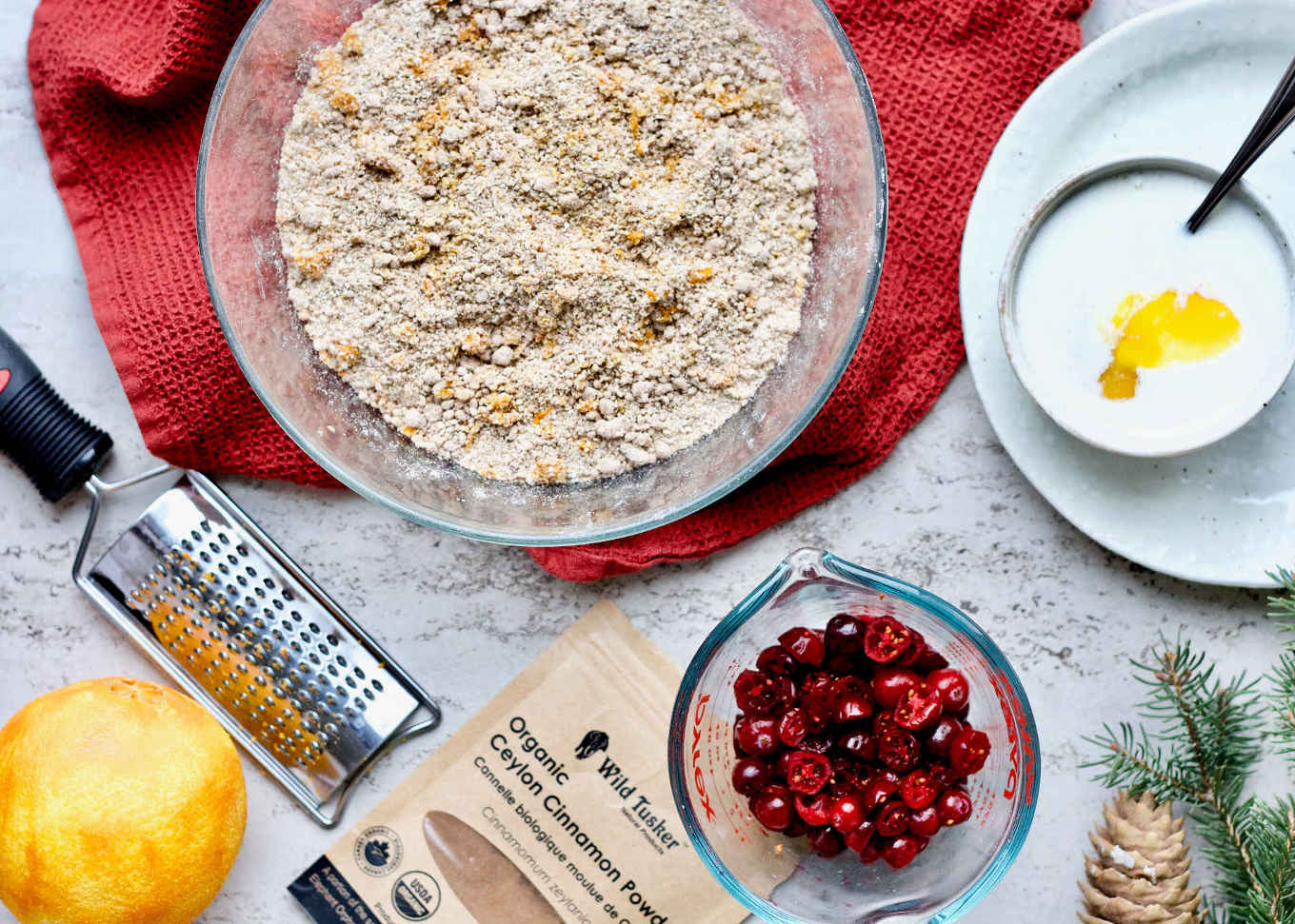 An overhead shot of the gluten-free orange cranberry coconut scones in the making and all the whole food ingredients.