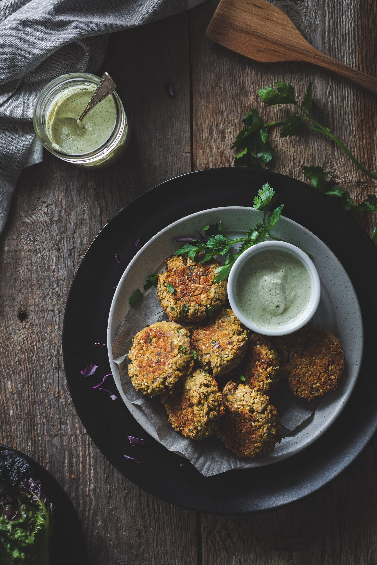Baked falafels with garlic dill sunflower dip, featured in 65+ nutrient dense real food snack recipes.
