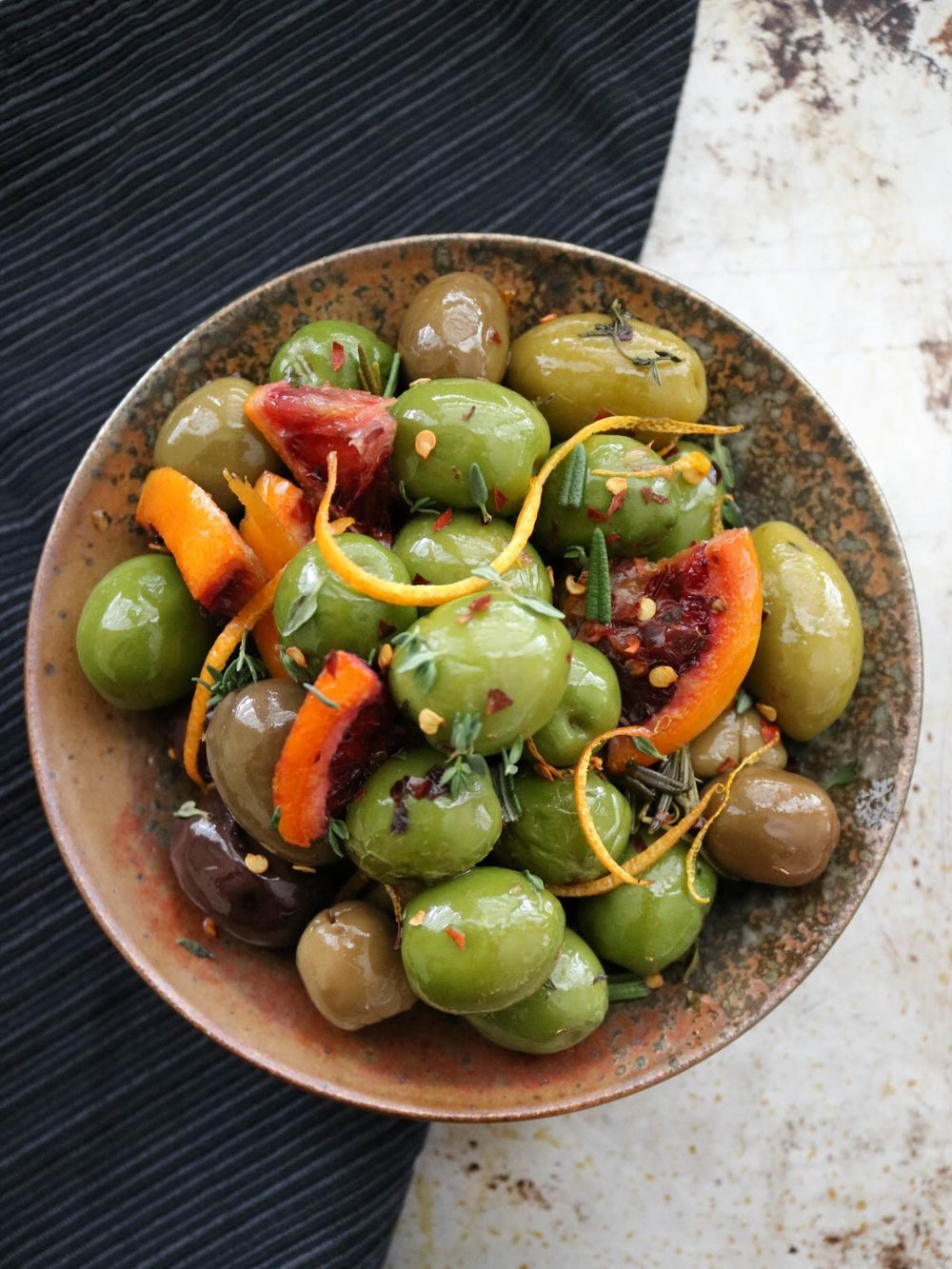 Citrus baked olives, featured in 65+ nutrient dense real food snack recipes.