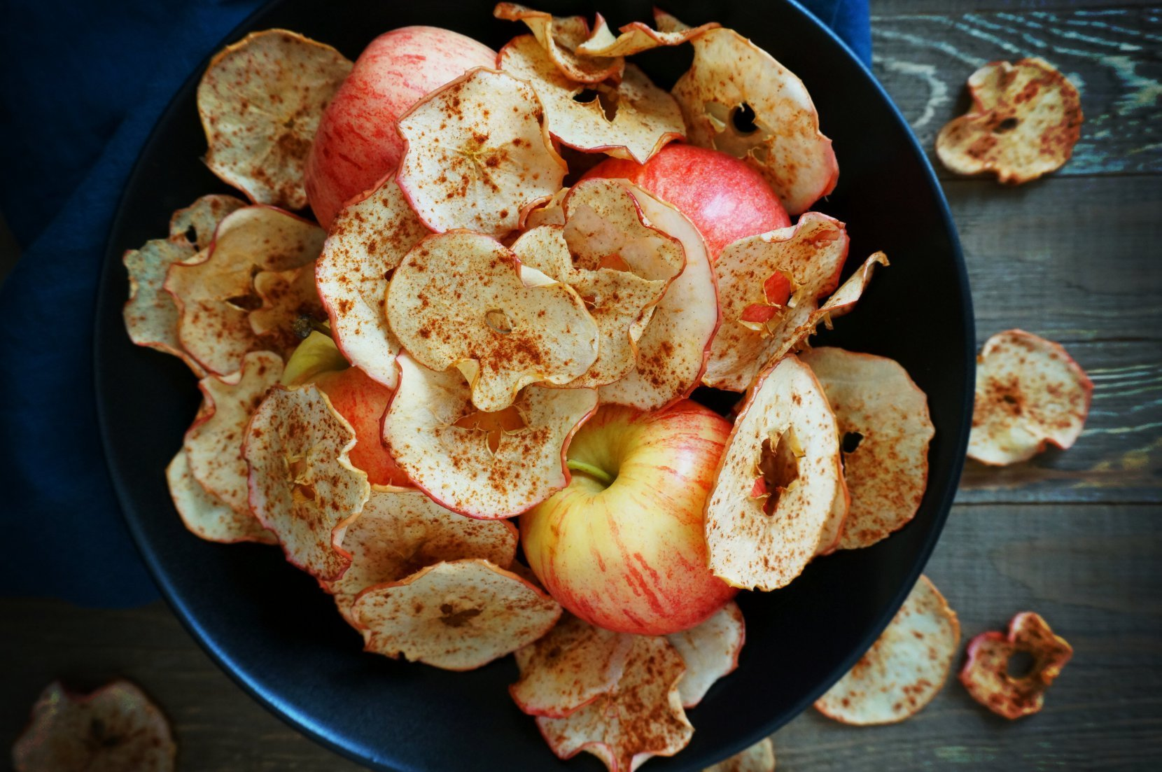 Sweet and salty cinnamon apple chips, featured in 65+ nutrient dense real food snack recipes.