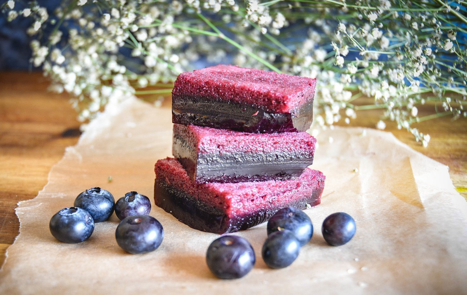 Paleo glowing skin blueberry jello, featured in 65+ nutrient dense real food snack recipes.