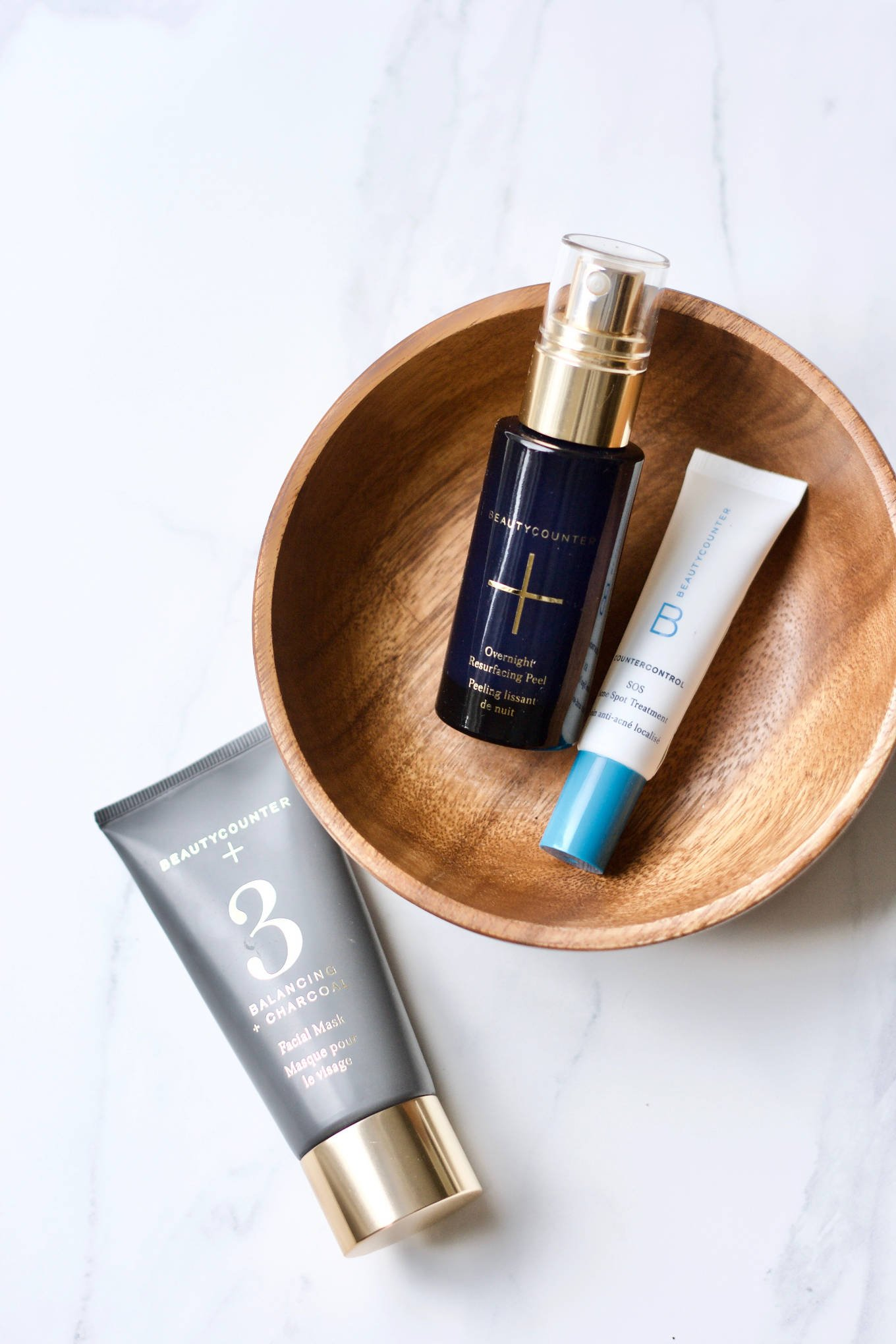 The 3 treatments from Beautycounter that everyone should have: overnight resurfacing peel, #3 charcoal mask, and SOS acne spot treatment.