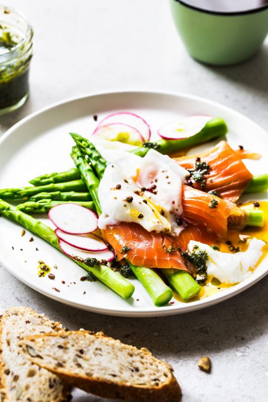 """Smoked Salmon with Poached Eggs, Roe, & Asparagus"" of best keto breakfast recipes"