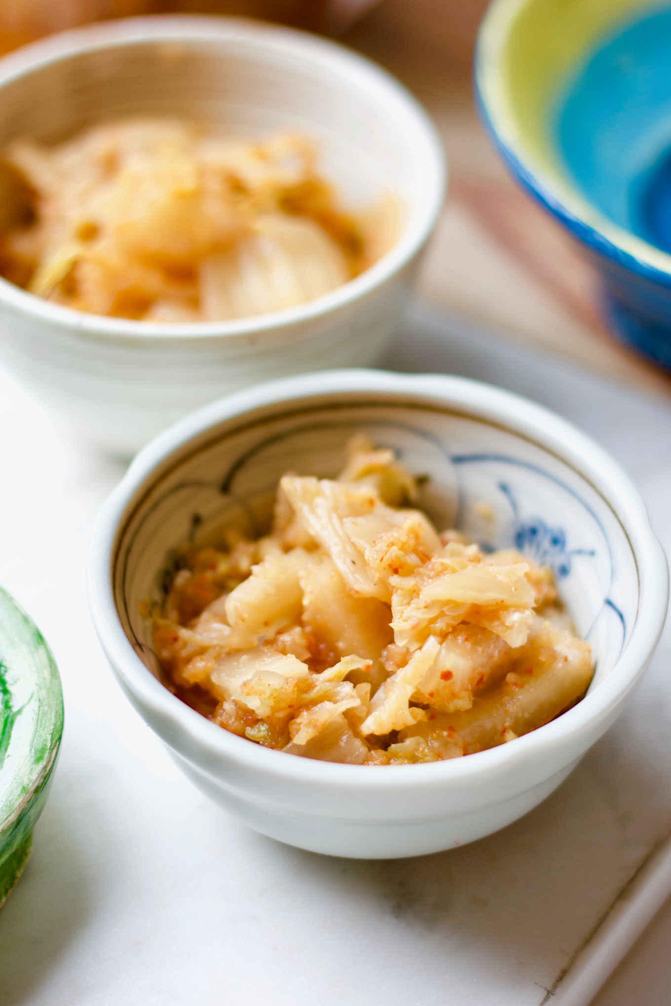 apple fermented kimchi in a small serving bowl