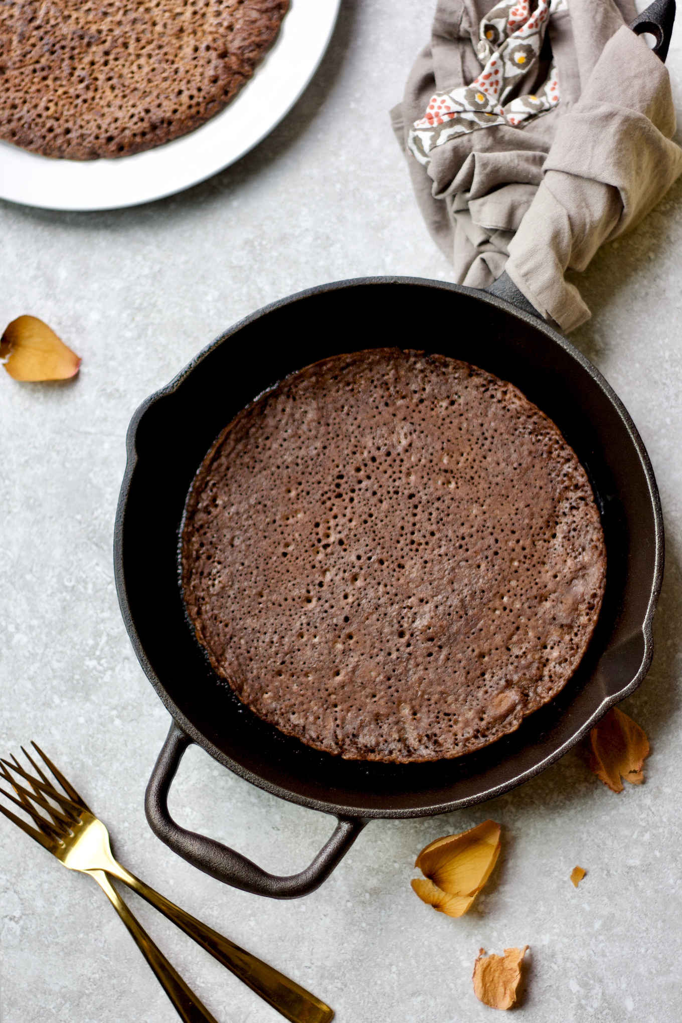 injera made in a cast iron skillet