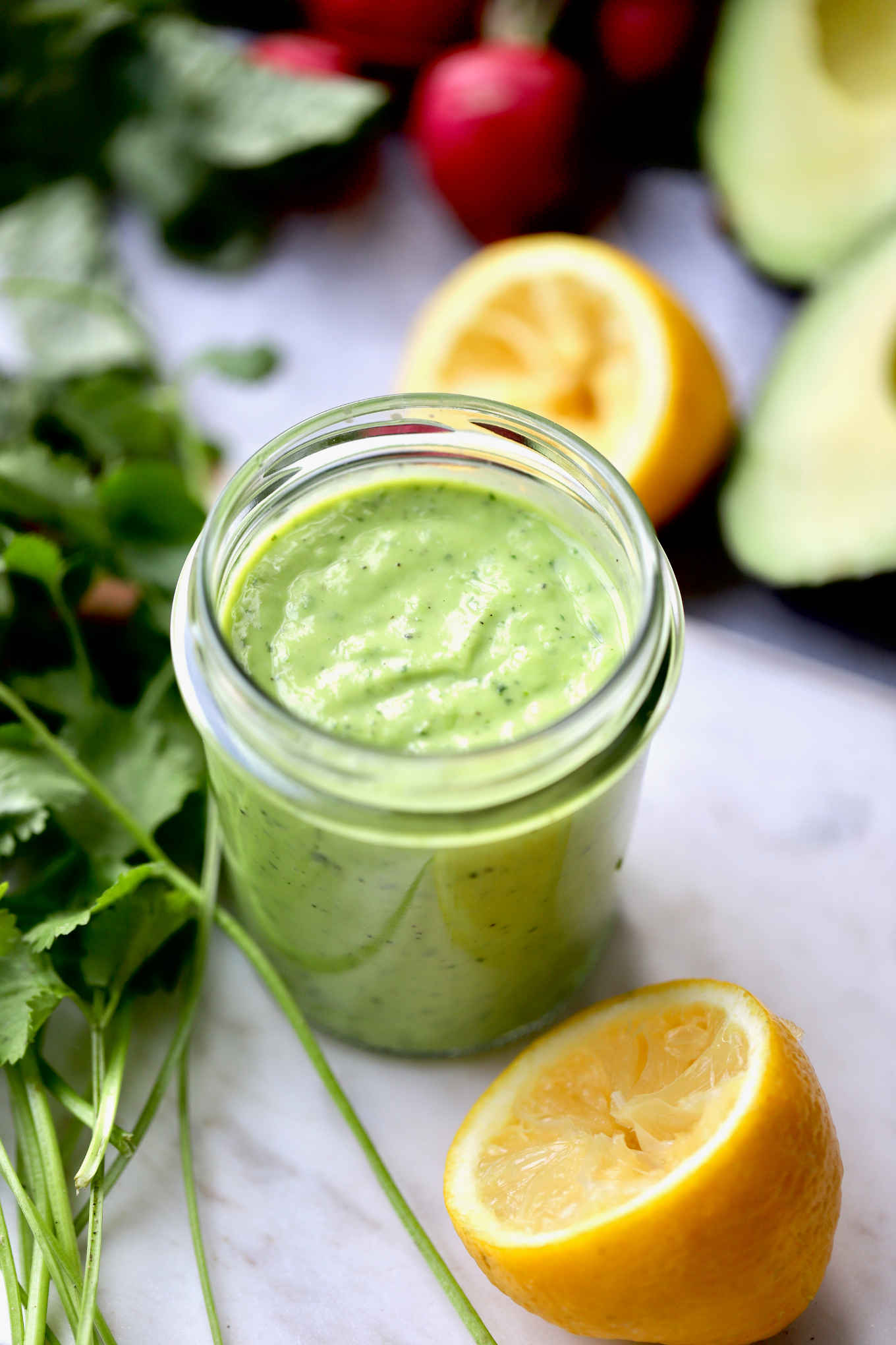 creamy avocado dressing in a jar