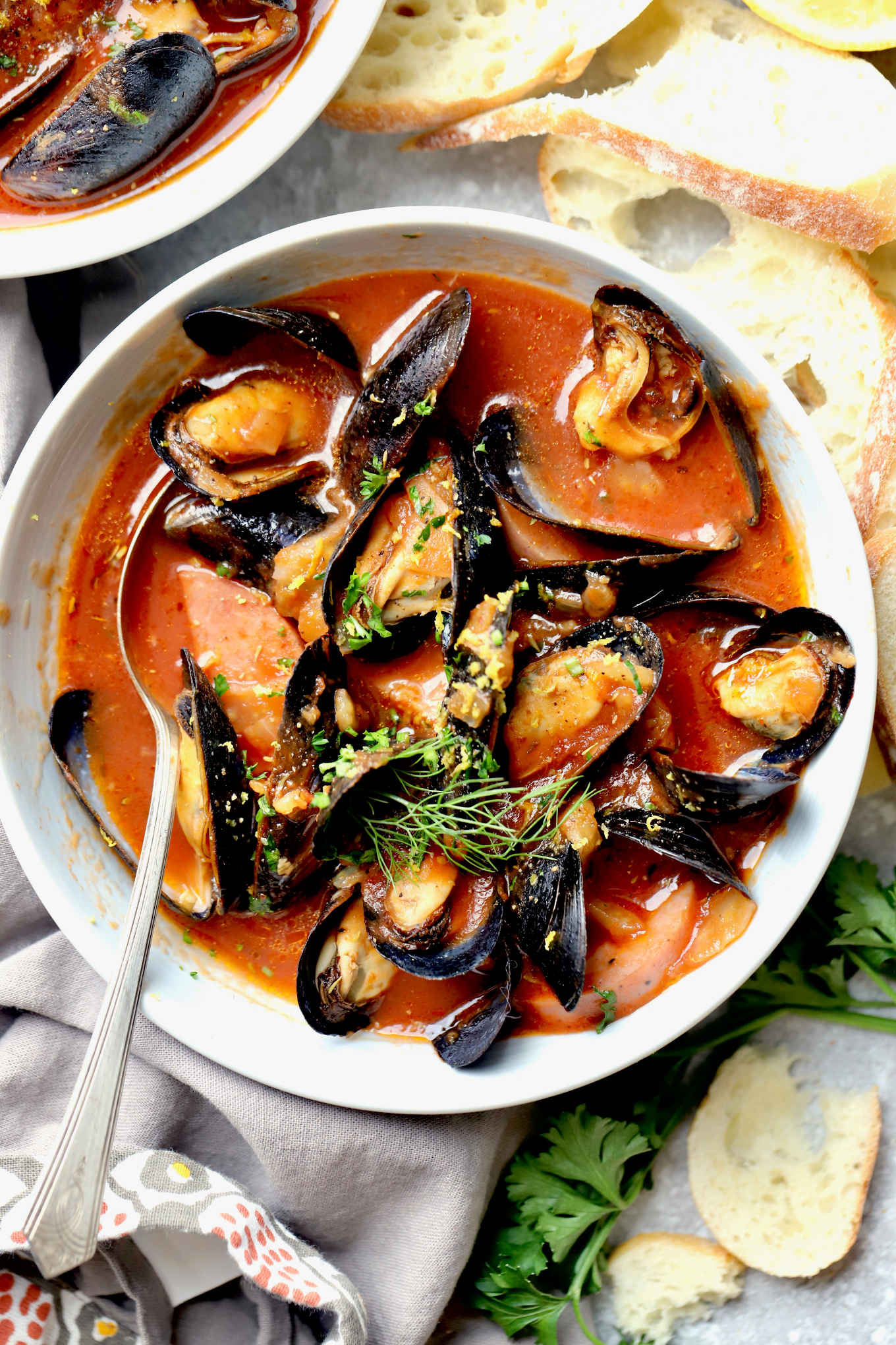 a bowl of paleo sausage and mussels in tomato broth