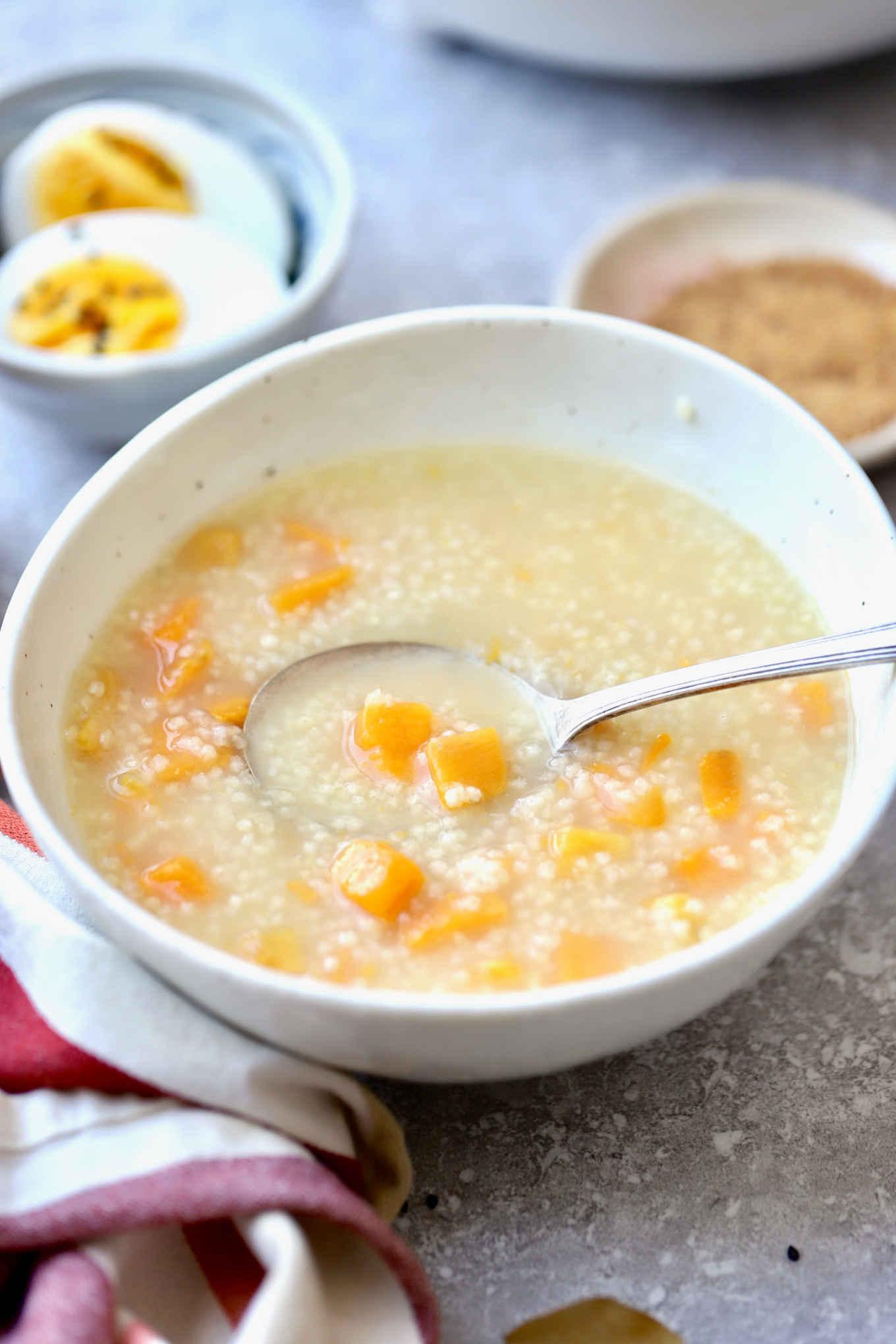 a bowl of millet sweet potato porridge on the breakfast table