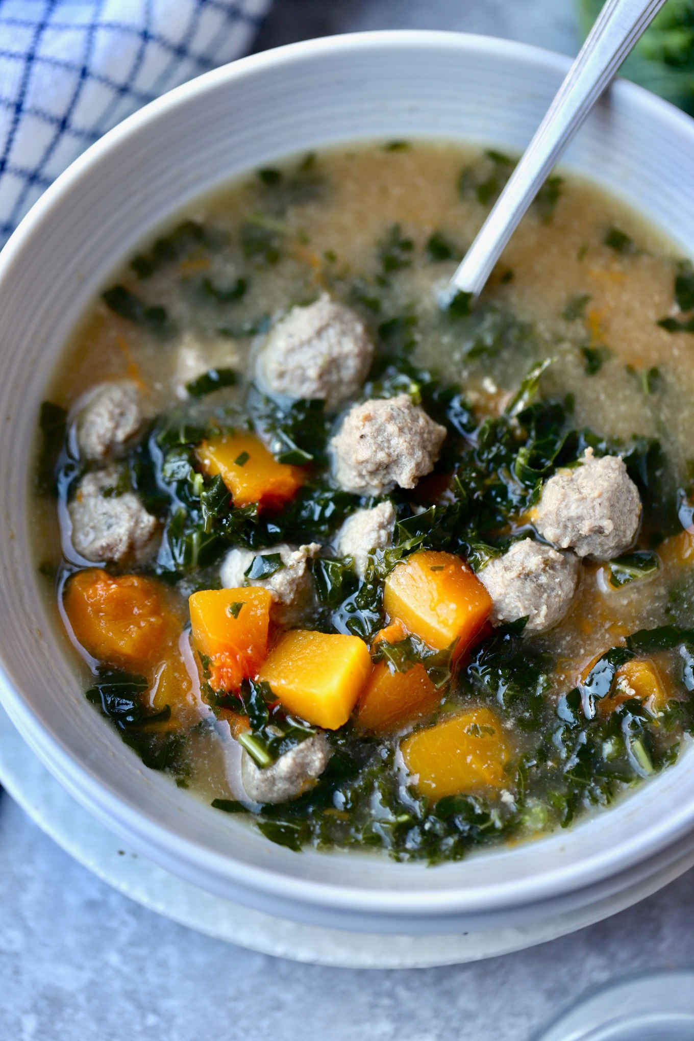 closeup shot of a bowl of winter meatball and vegetable soup